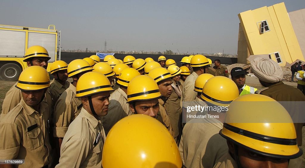 The rescue team on duty during a mock drill session at Burari ground on December 4,2102 in New Delhi, India. Mock Drill performs at various place in the capital to test the alertness and responds during the time of emergency situation such as Earthquake, Fire, Bomb Blast.