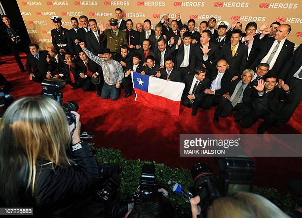 The rescued Chilean miners pose with their national flag on the red carpet of the 'CNN Heroes An AllStar Tribute' awards show at the Shrine...