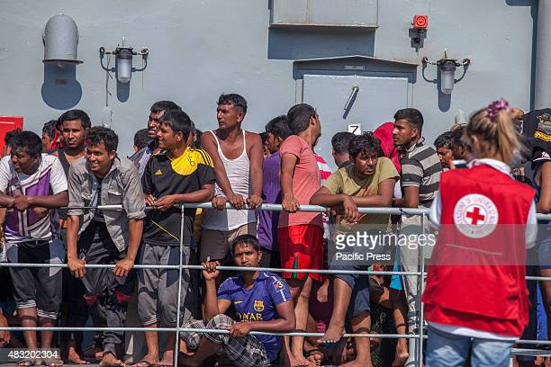 The rescued people are brought to Palermo by Irish patrol vessel Niamh Niamh was first to arrive on the scene to rescue the migrants after their ship...