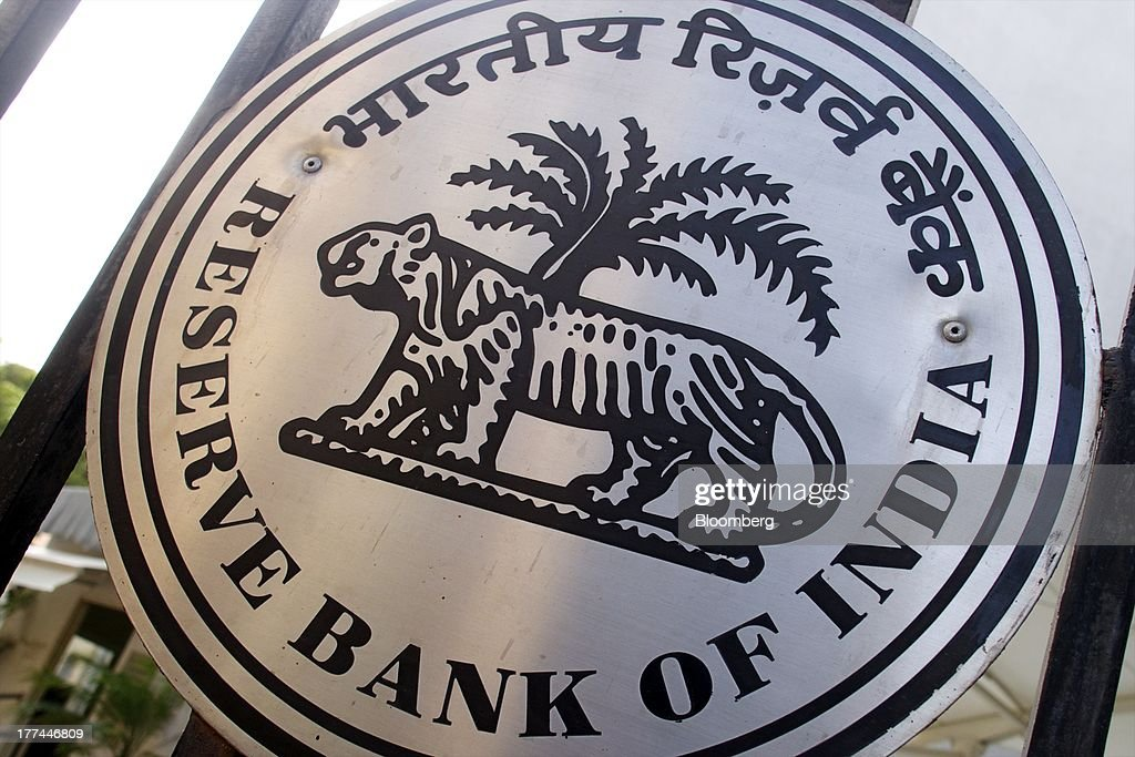 The Reserve Bank of India logo is displayed on a gate at the central bank's headquarters in Mumbai India on Friday Aug 23 2013 Indias rupee plunged...