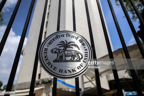 The Reserve Bank of India logo is displayed on a gate at the central bank's headquarters in Mumbai India on Monday Sept 2 2013 Raghuram Rajan who is...