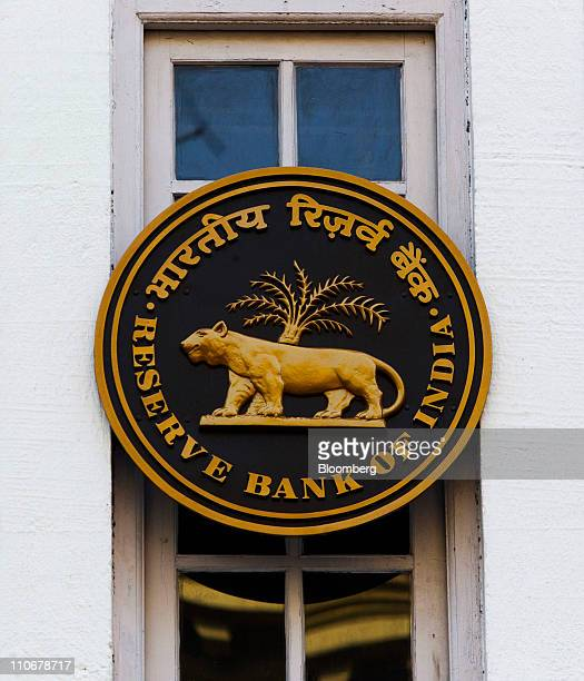 The Reserve Bank of India logo is displayed outside a bank branch in Kolkata India on Monday March 14 2011 India faces pressure to step up its battle...