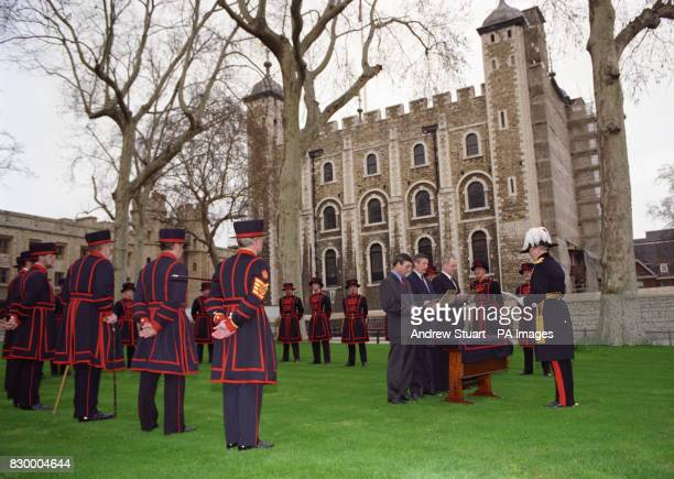 The Resident Governor of the Tower of London Major General Geoffrey Field officiates as Alan Kingshott Christopher Morton and Nicholas Thompson swear...