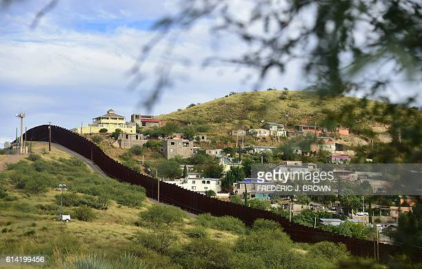 The residential neighbourhood of Nogales in the state of Sonora on the Mexico side of the border is seen across the border wall from Nogales Arizona...