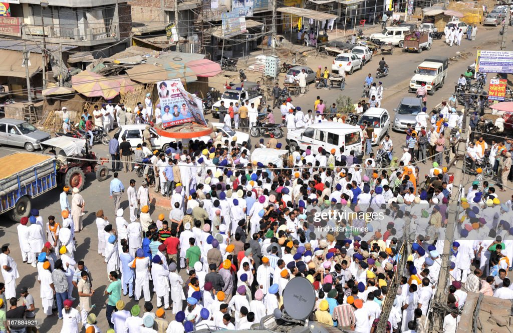 The residents of Indian prisoner in Pakistan Sarabjit Singh's native village Bikhiwind blocking the main roads while protesting against the Pakistan and Indian Government on May 2, 2013 about 40 KMS from Amritsar, India. Sarabjit Singh, died early today after being comatose for almost a week following an attack by other prisoners at a Lahore jail.