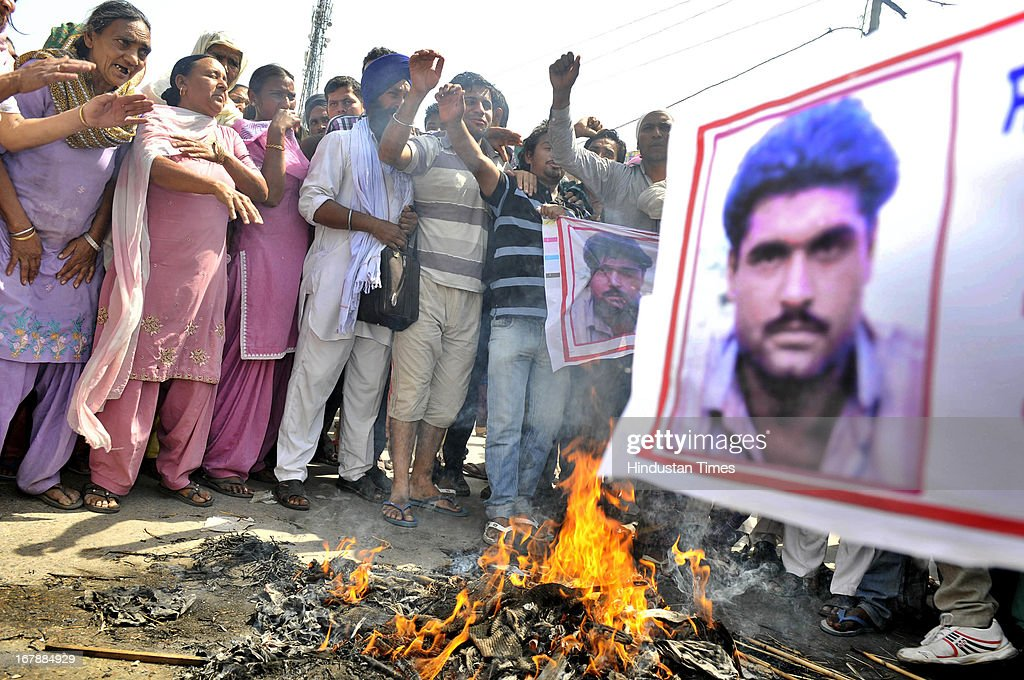 The residents of Indian prisoner in Pakistan Sarabjit Singh's native village Bikhiwind blocking the main road and burning the effigy of Pakistan and Indian governments during protest on May 2, 2013 about 40 KMS from Amritsar, India. Sarabjit Singh, died early today after being comatose for almost a week following an attack by other prisoners at a Lahore jail.