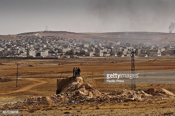 The residents of Kobani a Kurdish town on the Syrian border watch as the US and coalition forces make airstrikes on the key positions of ISIS...