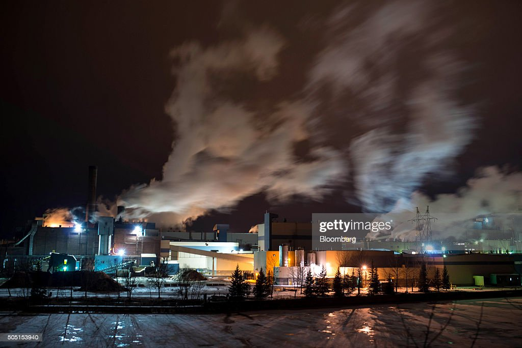 The Resolute Forest Products mill stands across the Kaministiquia River at night in Thunder Bay Canada Ontario on Wednesday Jan 6 2016 Resolute...