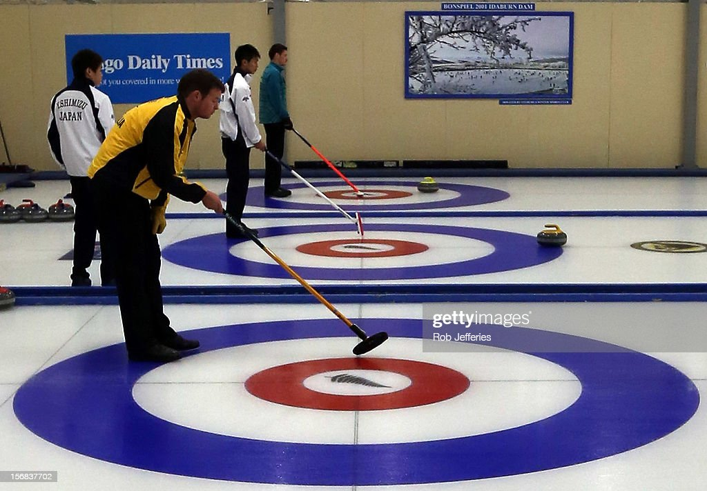 The respective Australia, Japan and Kazakhstan teams line up the target for there team-mates during the Pacific Asia 2012 Curling Championship at the Naseby Indoor Curling Arena on November 23, 2012 in Naseby, New Zealand.