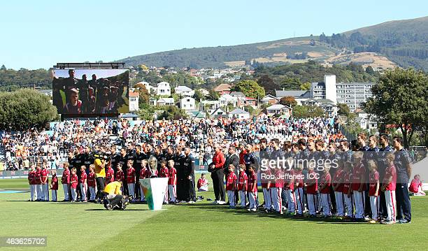 The respective New Zealand and Scotland teams stand for their National Anthems during the ICC Cricket World Cup match between New Zealand and...