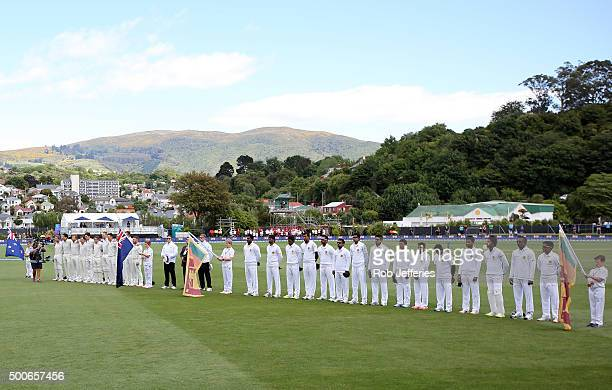 The respective New Zealand and Sri Lanka teams stand during their National Anthems during day one of the First Test match between New Zealand and Sri...
