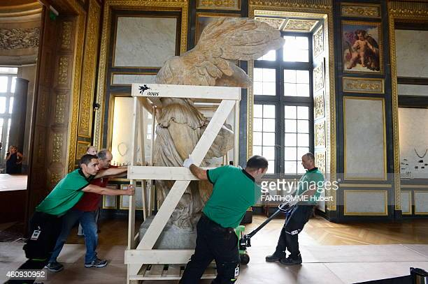 The restoration of the statue La Victoire de Samothrace at the Louvres Museum on September 10 2013 in Paris France