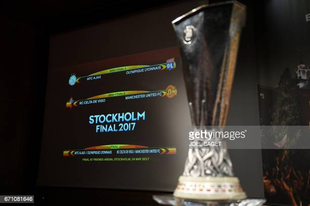 The result of the UEFA Europa league draw for the football competition's semifinals is displayed on a screen next to the trophy on April 21 2017 in...