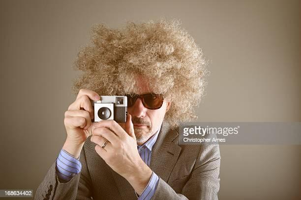 Le photographe prend la photo rétro