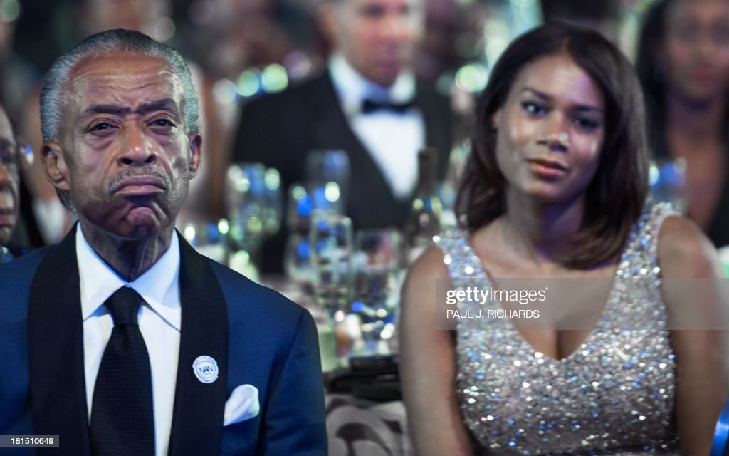 The Rev. Al Sharpton(L) 58-yrs and his girlfriend Aisha McShaw, (R) 35-yrs, listen to US President Barack Obama deliver remarks at the Congressional Black Caucus Foundation, Inc. (CBCF) Annual Phoenix Awards September 21, 2013 at the Washington Convention Center in Washington, DC. AFP Photo/Paul J. Richards