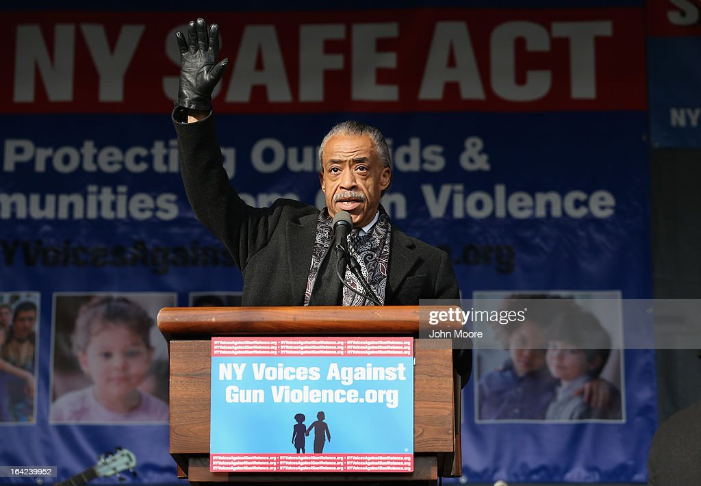 The Rev. <a gi-track='captionPersonalityLinkClicked' href=/galleries/search?phrase=Al+Sharpton&family=editorial&specificpeople=202250 ng-click='$event.stopPropagation()'>Al Sharpton</a> joins demonstrators in a rally against gun violence on March 21, 2013 in the Harlem neighborhood of the Manhattan borough of New York City. The group Moms Demand Action for Gun Sense In America as well as gun violence victims, youth organizations, healthcare workers, unions, elected officials, faith leaders and artists demonstrated to promote New York Gov. Andrew Cuomo's NY SAFE Act as a national model for federal gun control legislation.
