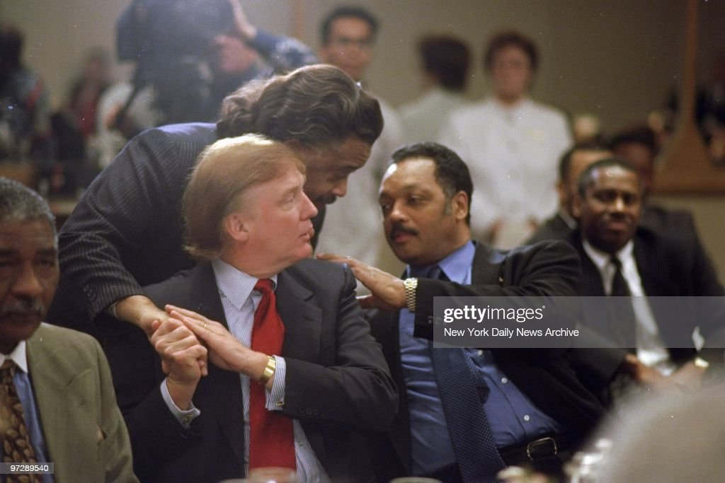 The Rev. Al Sharpton leans to talk to the Rev. Jesse Jackson as he shakes hands with Donald Trump during launching of the Rainbow Coalition's Wall Street Project at the World Trade Center Marriot Marquis.