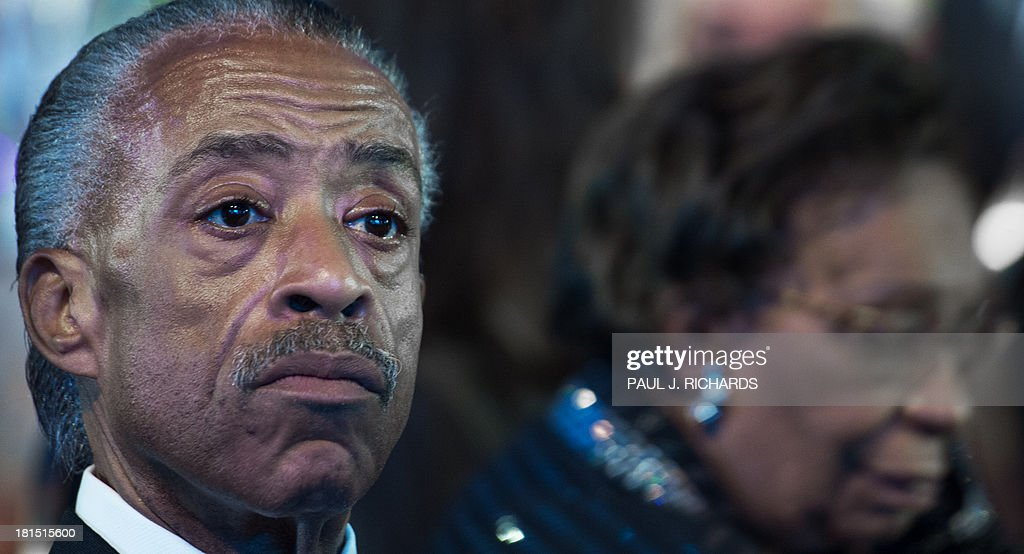 The Rev. Al Sharpton(L) listens to US President Barack Obama deliver remarks at the Congressional Black Caucus Foundation, Inc. (CBCF) Annual Phoenix Awards September 21, 2013 at the Washington Convention Center in Washington, DC. AFP Photo/Paul J. Richards