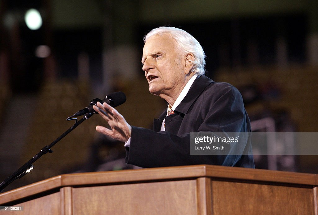 The Rev. Billy F. Graham speaks to the crowd on a rainy night October 7, 2004 at Arrowhead Stadium in Kansas City, Missouri. Graham is conducting his 'Heart of America' crusade in Kansas City October 7-10.