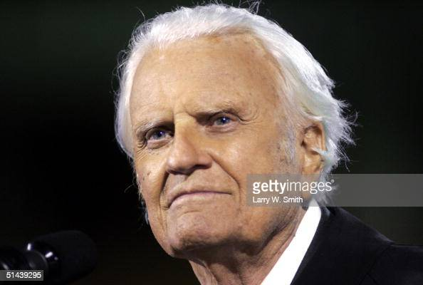 The Rev Billy F Graham speaks to the crowd on a rainy night October 7 2004 at Arrowhead Stadium in Kansas City Missouri Graham is conducting his...