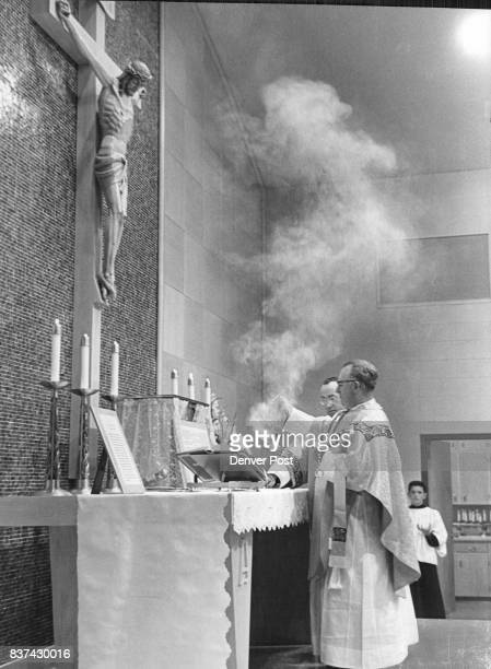 The Rev D A Lemieux pastor of St Catherine's Catholic Church performs incensation of the Mass Monday at dedication of Our Lady of Fatima Catholic...