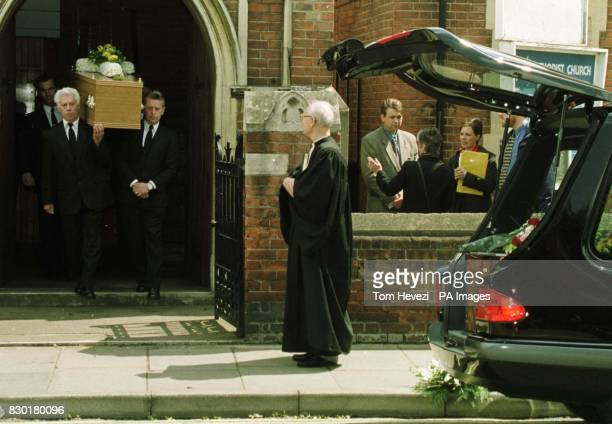 The Rev Dr Robert Bean waits as the coffin of John Light is carried out after his funeral service at the Wimpole Road Methodist Church in Colchester...
