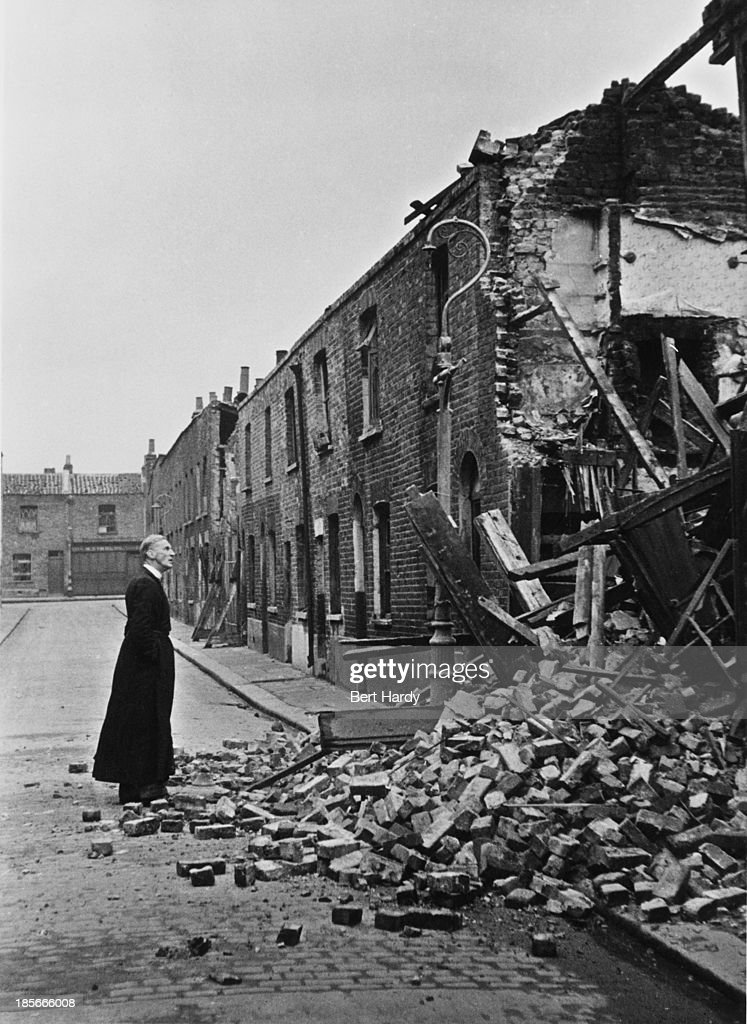The Rev French the Church of England's Rural Dean of Stepney makes his rounds through the bombdamaged streets of east London during the Blitz...