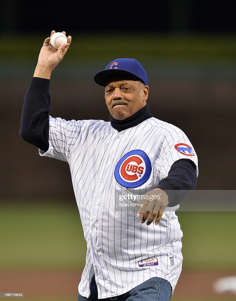 The Rev. Jesse Jackson Sr. throws out a ceremonial first pitch on Jackie Robinson Day before a game between the Chicago Cubs and the Texas Rangers at Wrigley Field on April 16, 2013 in Chicago, Illinois.