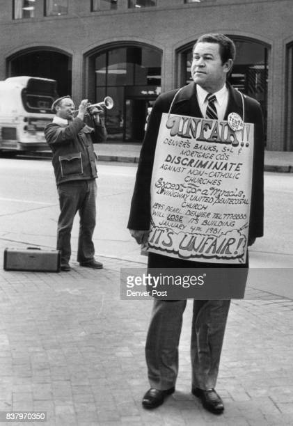 The Rev Maurice Gordon In Sandwich Board Pickets Bill Carey played trumpet while Gordon protested inability to get loan Credit Denver Post