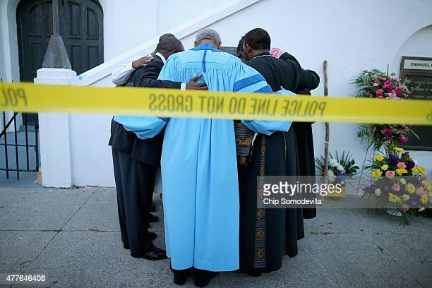 The Rev Sidney Davis and other area pastors pray together outside the historic Emanuel African Methodist Episcopal Church June 18 2015 in Charleston...
