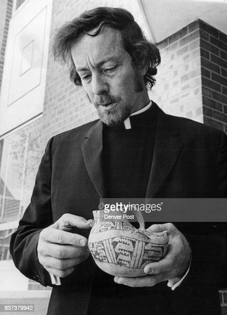 The Rev Thomas J Steele Examines Pueblan Effigy Jar 'Found' At Regis Credit Denver Post