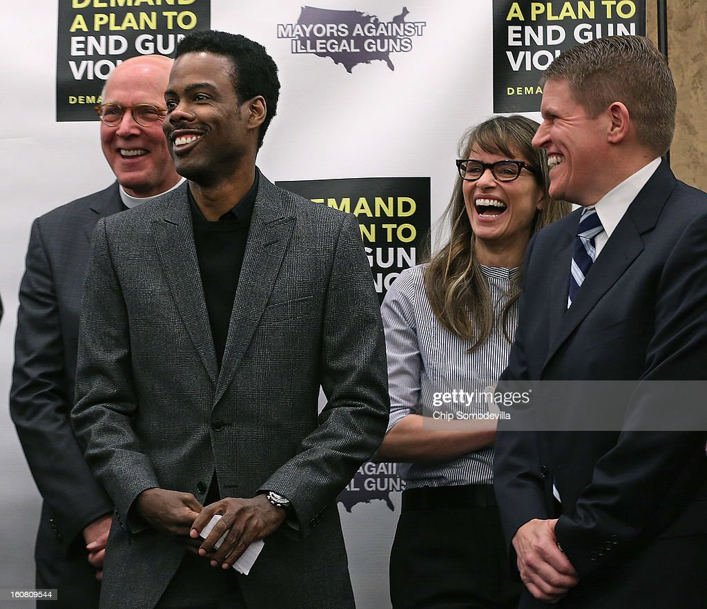 The Rev. Thomthy Boggs, actor Chris Rock, actor Amanda Peet and former ATF Agent David Chipman share a laugh during a press conference hosted by Mayors Against Illegal Guns and the Law Center to Prevent Gun Violence at the U.S. Capitol February 6, 2013 in Washington, DC. The artists, activists and politicians called for manditory background check on all gun purchases among other restrictions.