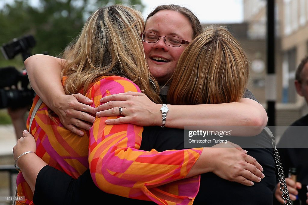 The Revd Dr Hannah Cleugh (C) embraces church members after the Church of England General Synod gave their backing to the ordination of women bishops at York University on July 14, 2014 in York, England. Members and officers of the Church of England's General Synod have voted in favour to introduce women bishops. The first women bishops could be announced and ordained within the next year.