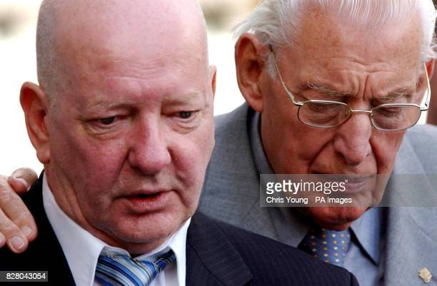 The Revd Dr Ian Paisley rests his hand on the shoulder of Bobby Baird one of the relatives of victims of the Shankhill Road bombing outside the...