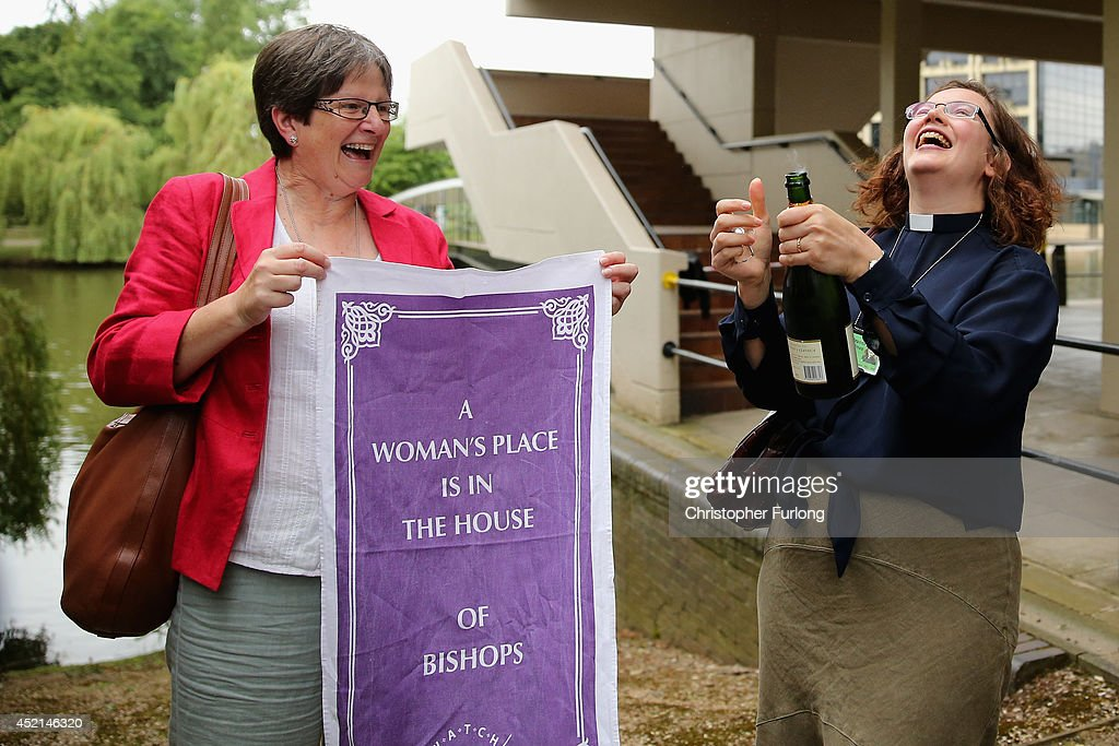 The Revd Dr Miranda Threfall-Holmes (R) and Hilary Cotton celebrate with Champagne after the Church of England General Synod gave their backing to the ordination of women bishops at York University on July 14, 2014 in York, England. Members and officers of the Church of England's General Synod have voted in favour to introduce women bishops. The first women bishops could be announced and ordained within the next year.