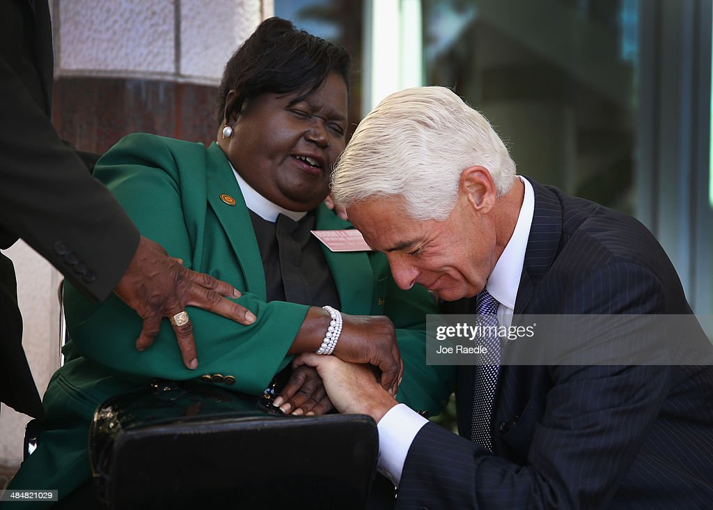 The Reverand Edrena H Brown prays with former Florida Republican Governor Charlie Crist, who is currently the leading Democrat trying to unseat incumbent Republican Gov. Rick Scott, as he arrives to speak during the Forum Club of the Palm Beaches at the Cohen Pavilion at the Kravis Center on April 14, 2014 in West Palm Beach, Florida. The former governor is showing a slight edge in the polls over Rick Scott as the campaign starts to heat up for the 2014 Florida gubernatorial election that will take place on November 4, 2014.