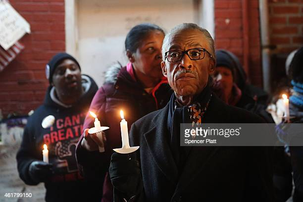 The Reverend Al Sharpton leads a candlelight vigil and wreath laying ceremony at the location where Eric Garner was killed during a scuffle with...