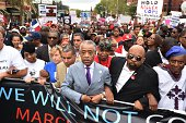 The Reverend Al Sharpton marches with protesters at a rally against police brutality in memory of Eric Garner August 23 2014 in Staten Island New...