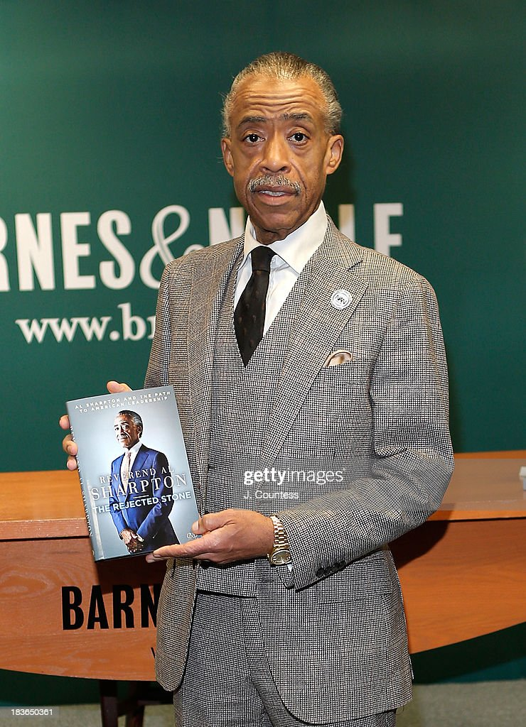 The Reverend <a gi-track='captionPersonalityLinkClicked' href=/galleries/search?phrase=Al+Sharpton&family=editorial&specificpeople=202250 ng-click='$event.stopPropagation()'>Al Sharpton</a> poses for a photo with a copy of His Book 'Rejected Stone: <a gi-track='captionPersonalityLinkClicked' href=/galleries/search?phrase=Al+Sharpton&family=editorial&specificpeople=202250 ng-click='$event.stopPropagation()'>Al Sharpton</a> And The Path To American Leadership' at Barnes & Noble, 5th Avenue on October 8, 2013 in New York City.