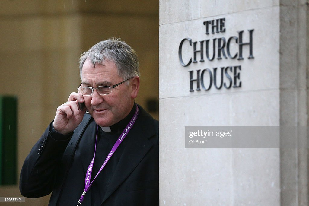 The Reverend Canon Glyn Webster speaks on his phone outside Church House on the final day of the General Synod on November 21, 2012 in London, England. The Church of England's governing body, known as the General Synod, yesterday voted to prevent women from becoming bishops.
