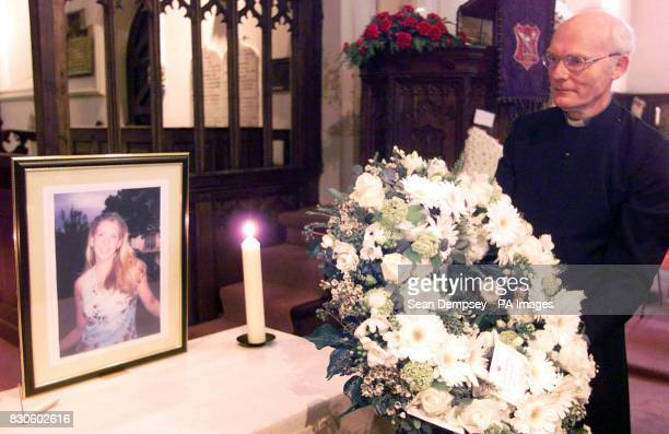 The Reverend Chris Walker lays a wreath from the Japanese Ambassador after the funeral of murdered hostess Lucie Blackman at St Nicholas Parish...