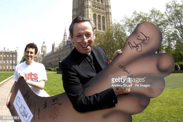The Reverend George Pitcher of St Bride's in Fleet Street signs his blessing upon a model of England Wayne Rooney's broken foot wishing him a...