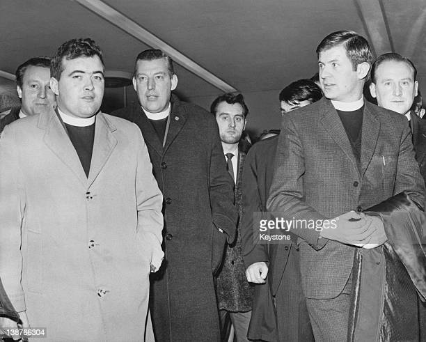 The Reverend Ian Paisley and supporters arriving at London Airport on his way to St Paul's Cathedral to protest when Cardinal Heenan is received by...