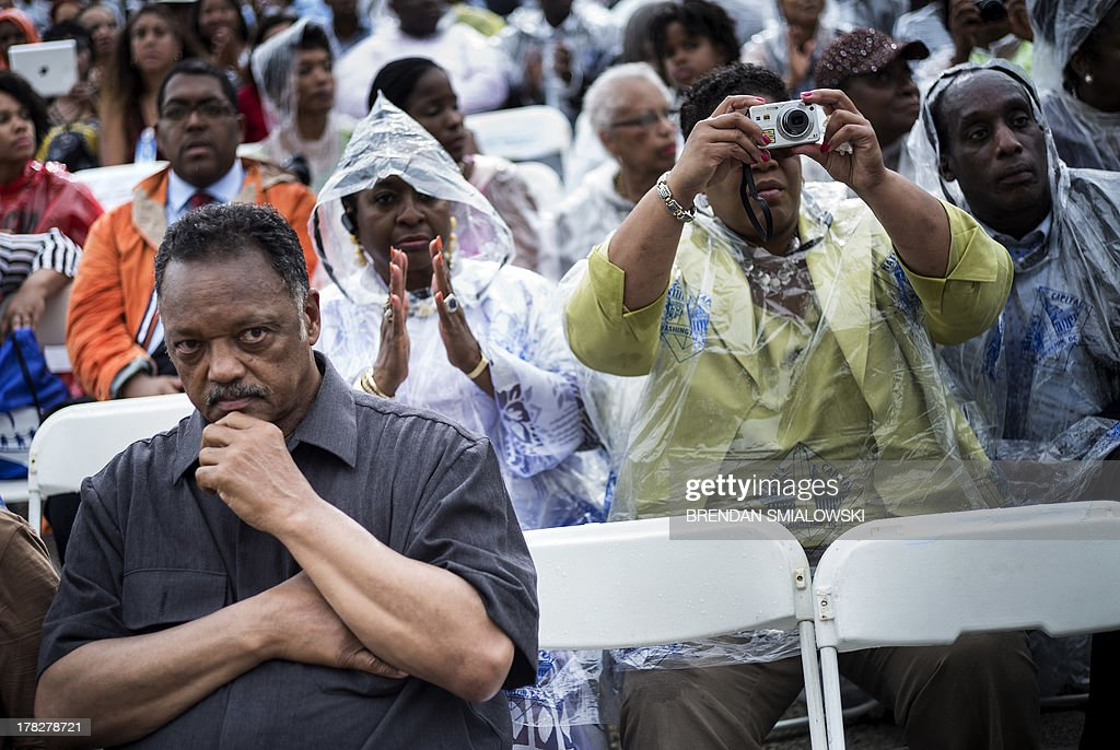 The Reverend Jesse Jackson and other wait to listen to US President Barack Obama speak at the Lincoln Memorial on the National Mall August 28, 2013 in Washington, DC. Obama and others spoke to commemorate the 50th anniversary of the US civil rights era March on Washington where Martin Luther King Jr. delivered his 'I Have a Dream Speech'. AFP PHOTO/Brendan SMIALOWSKI