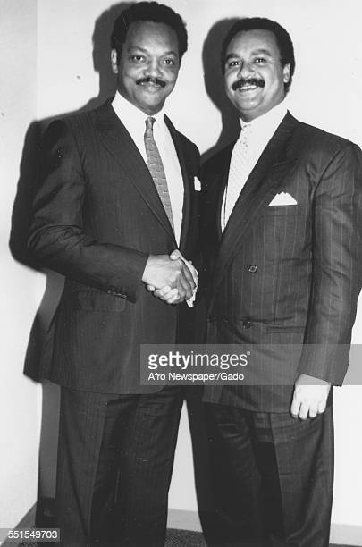 The Reverend Jesse Jackson first black chair of the Democratic National Committee shaking hands with Ronald H Brown on agreeing to hold a campaign to...