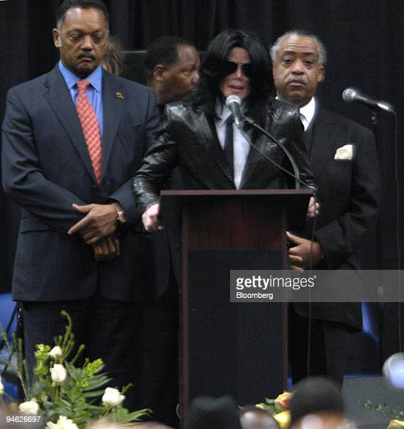 The Reverend Jesse Jackson left Michael Jackson performer center and the Reverend Al Sharpton give eulogies at the James Brown Arena during James...