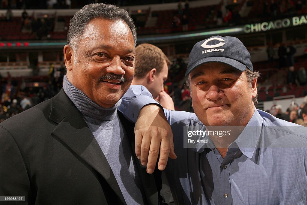 The Reverend Jesse Jackson (L) poses for a picture with actor and comedian Jim Belushi following the game between the Chicago Bulls and the Milwaukee Bucks on November 26, 2012 at the United Center in Chicago, Illinois.
