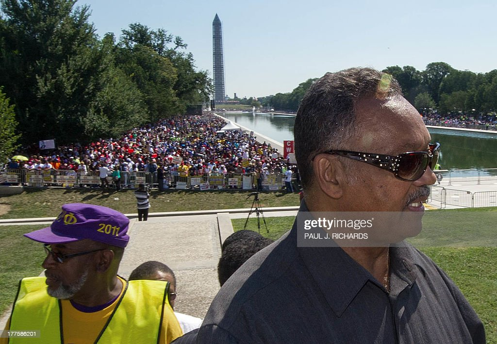 The Reverend Jesse Jackson walks to the Lincoln Memorial as thousands of people line the reflecting pool near the Lincoln Memorial while listening to speakers at the 50th anniversary of the March on Washington and Dr. Martin Luther King, Jr.'s 'I have a Dream' speech on August 24, 2013, in Washington, DC. AFP Photo/Paul J. Richards