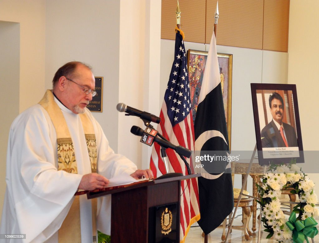 The Reverend Joseph Sobierajski from Washington's Holy Trinity Catholic Church says a prayer for Pakistan's assassinated minister for minorities, Shahbaz Bhatti, at the Pakistani embassy in Washington on March 9, 2011. Bhatti, 42, pictured at right, who opposed Pakistan's Islamic blasphemy laws, was shot as he left his mother's home in a residential area of Islamabad on March 2, 2011. Police said the attackers fired at least 25 bullets at his vehicle. A letter found at the scene, purportedly from supporters of Al-Qaeda and the Pakistani Taliban, claimed responsibility for the killing, police said.