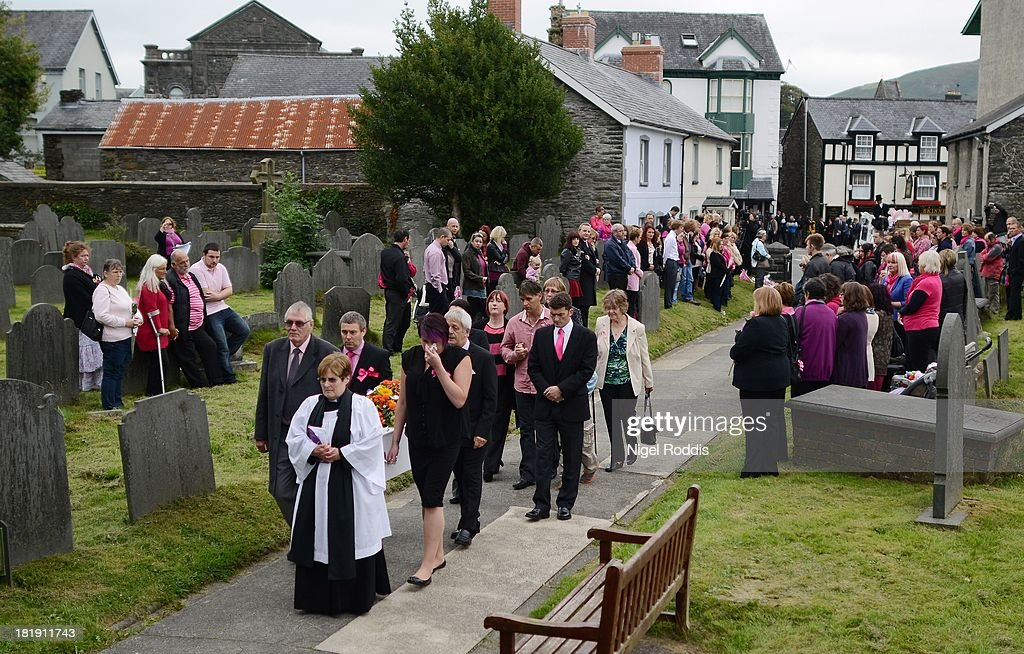 The Reverend Kathleen Rogers leads the cortege and family members carrying the coffin of murdered schoolgirl April Jones into St Peter's Church for her funeral service on September 26, 2013 in Machynlleth, Wales. Local man Mark Bridger, aged 47, was found guilty of abducting and murdering five-year-old April who went missing in Machynleth on October 1, 2012.